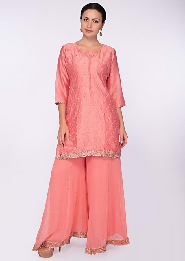 Punch Pink Suit With Jaal Embroidery Paired With Georgette Sharara And Chiffon Dupatta Online - Kalki Fashion