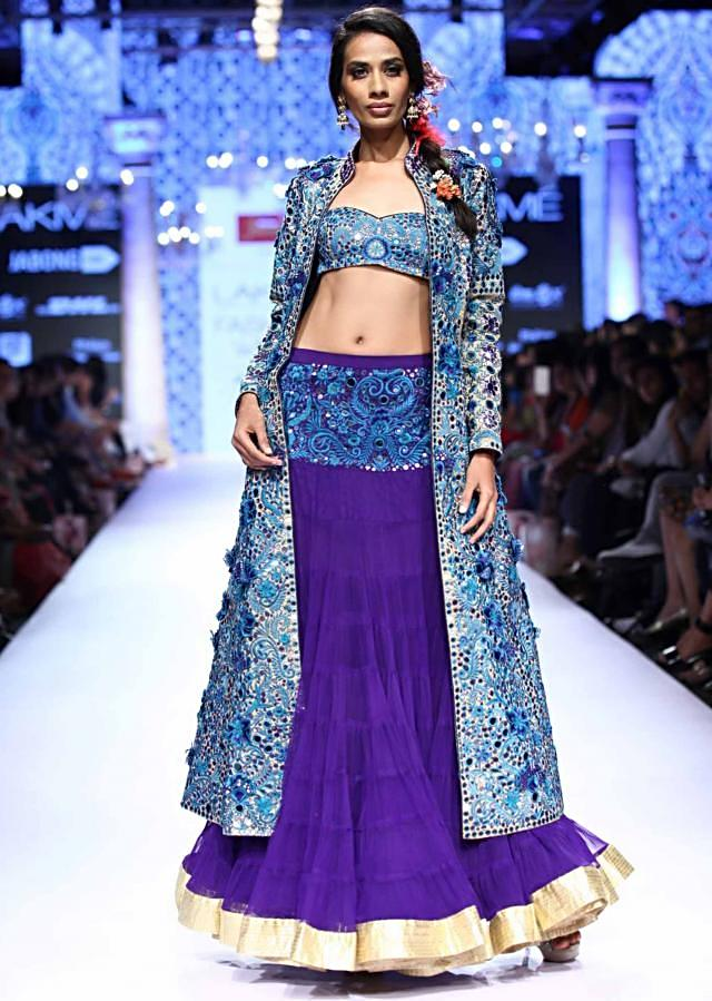 Model walks the ramp in purple lehenga with blue heavily adorn long jacket for Suneet Verma for his collection Decorative Arts of India at Lakme Fashion Week Summer Resort 2015