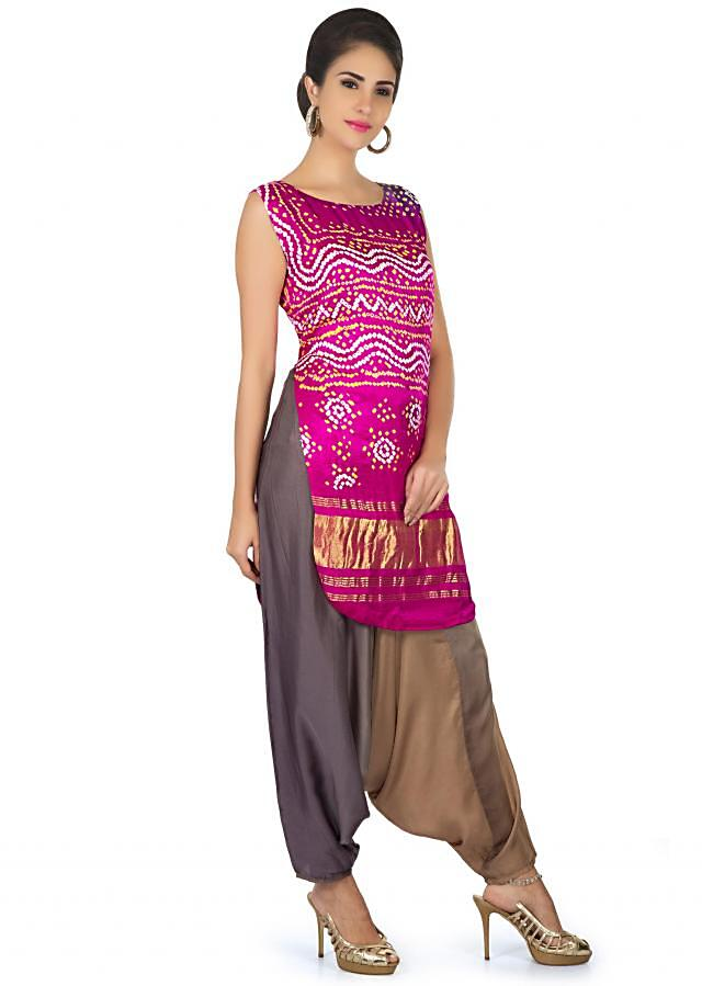 Purple pink satin top in bandhani print matched with Aladdin pants only on Kalki