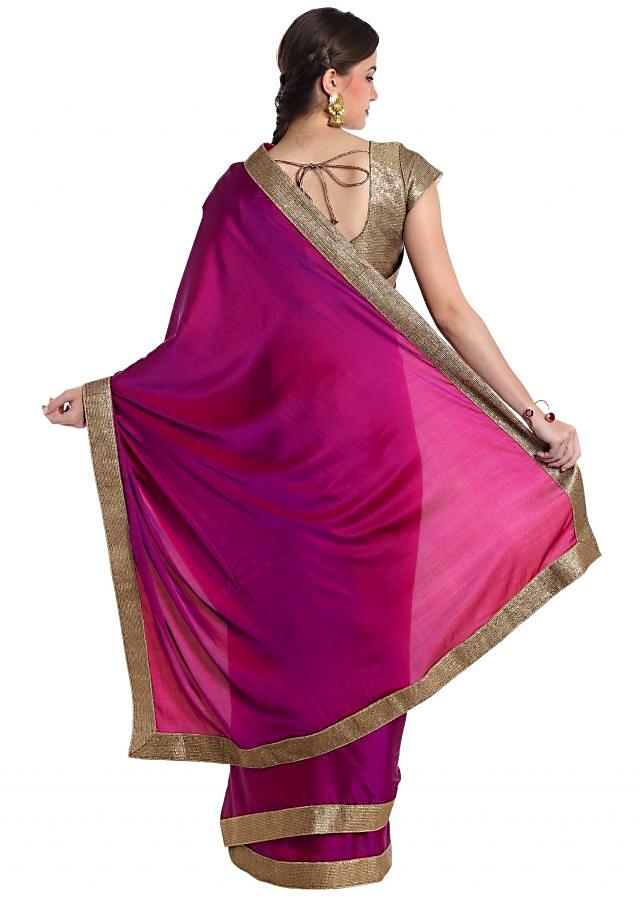 Purple satin saree styled with a gold border only on Kalki