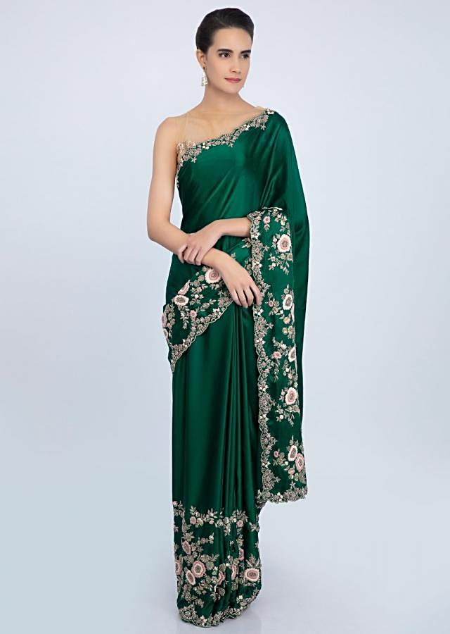 Rama green satin saree in multi color floral embroidered border only on Kalki