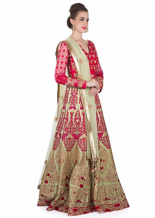 Rani Pink and Green Cotton Silk Top and Net Dupatta Adorned with Resham Embroidery and Zari only on Kalki
