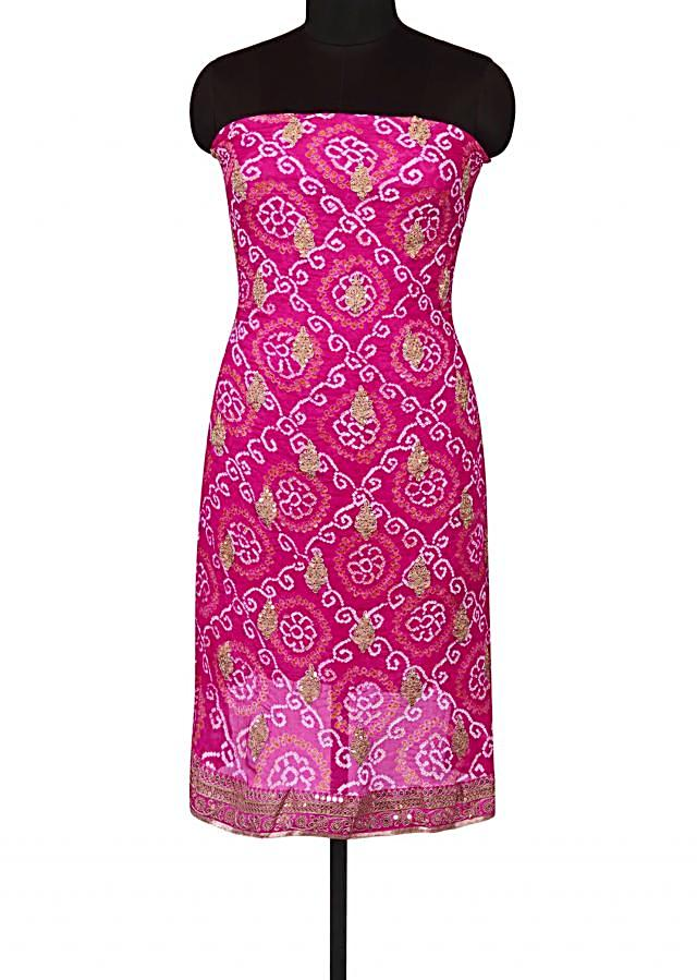 Rani pink bandhani unstitched suit in zari butti and border only on Kalki