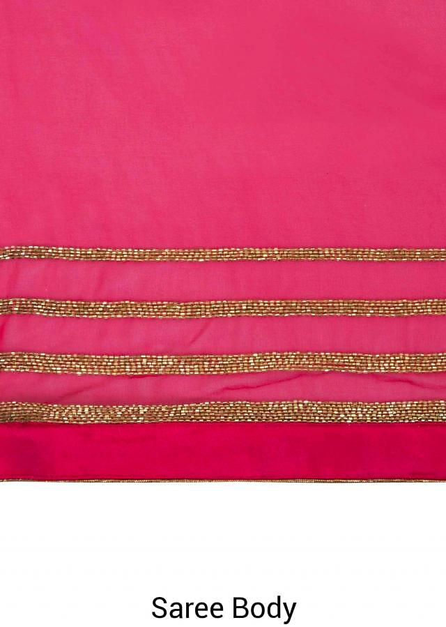 Rani pink georgette saree adorned with cut dana work only on Kalki