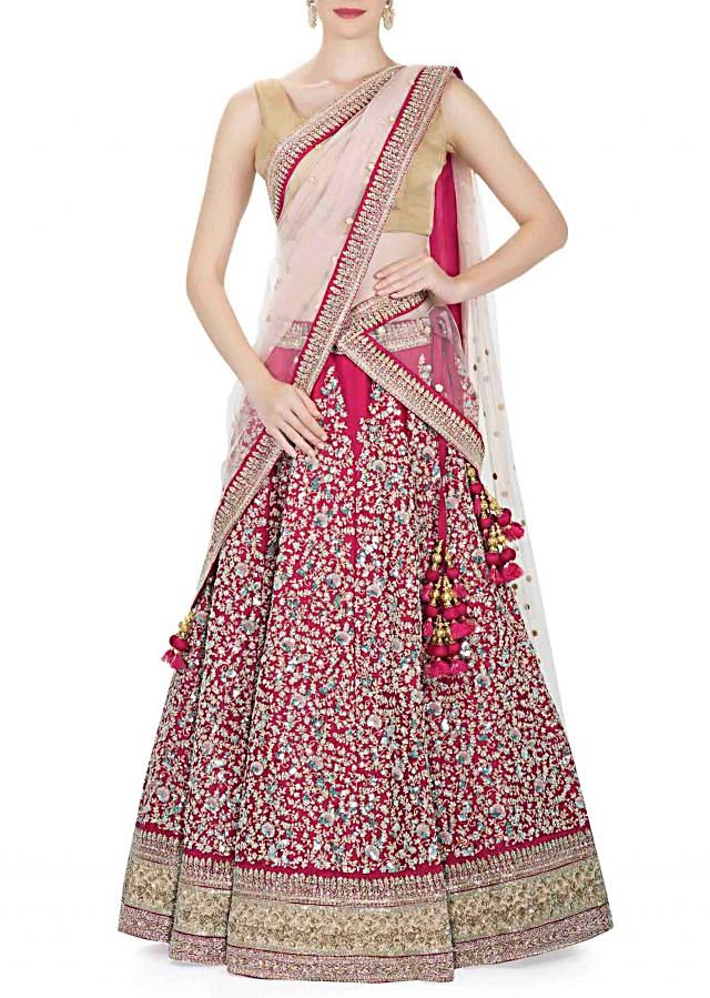 Rani Pink Lehenga, Blouse with Light Pink Net Dupatta Flaunting Sequins and Thread Work only on Kalki