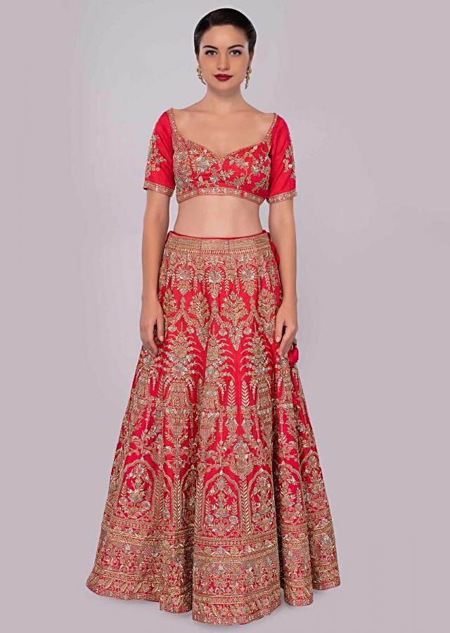 Rani pink raw silk embroidered lehenga set with peach net dupatta only on Kalki