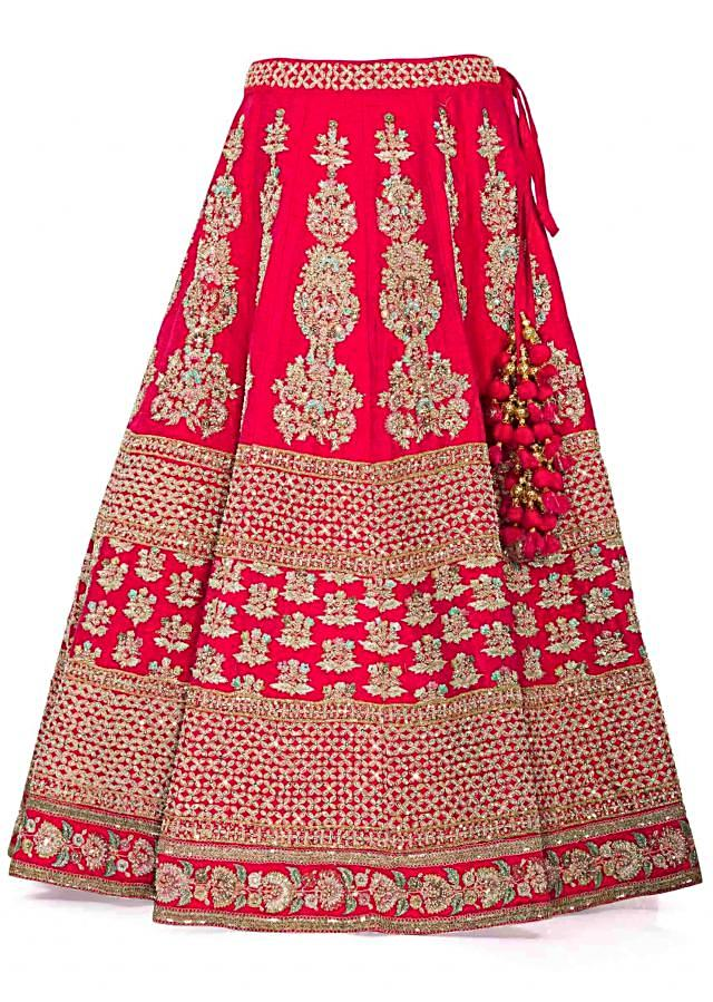 Rani Pink Raw Silk Lehenga, Blouse and Net Dupatta Adorned with Thread Work and Kundan only on Kalki