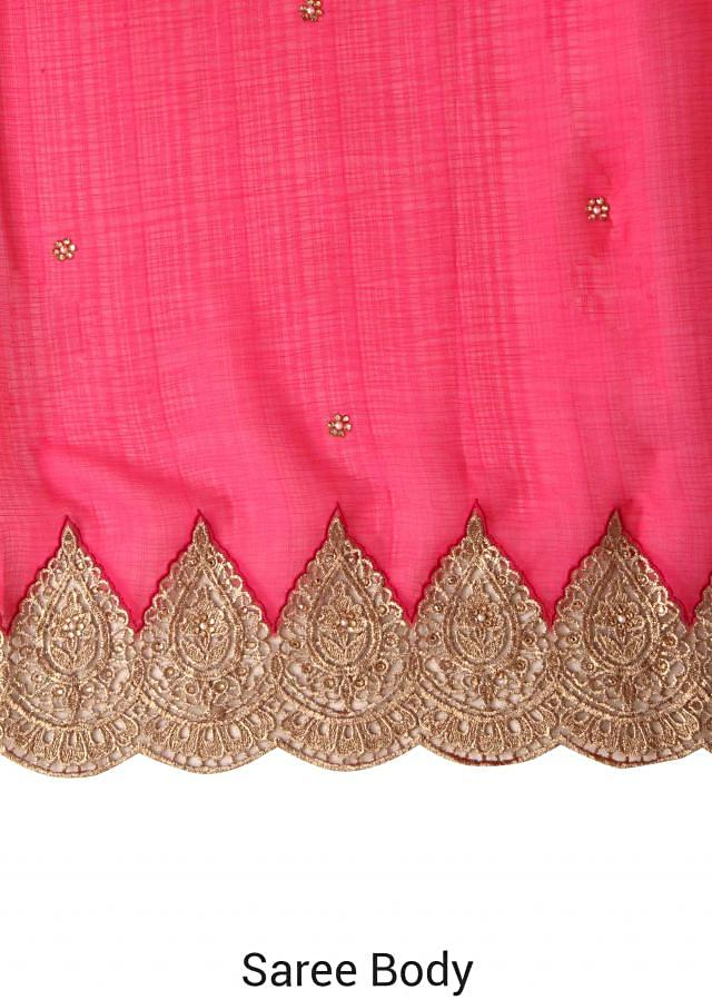 Rani pink saree features with zari embellished border only on Kalki