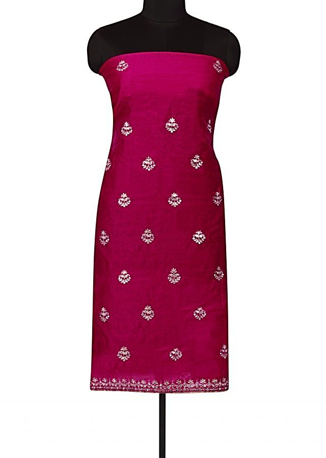 Rani pink unstitched suit in cotton silk with zari butti only on Kalki