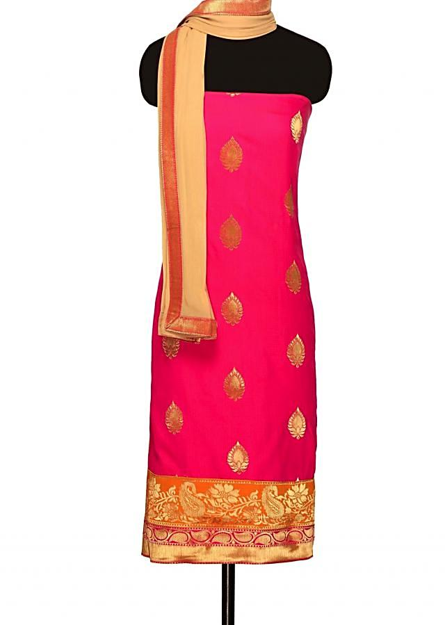 Rani pink unstitched suit with beige dupatta only on Kalki