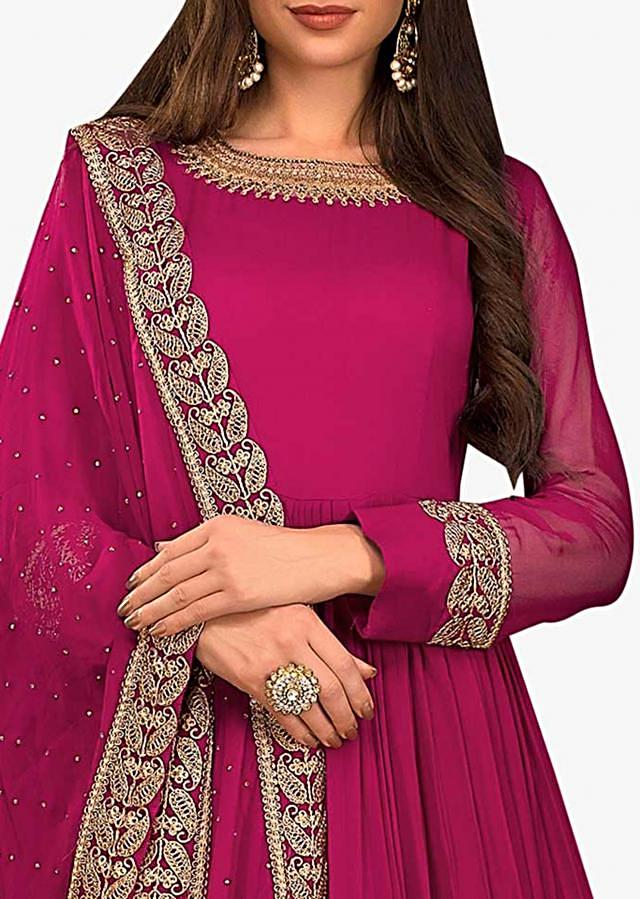 Rani pink anarkali suit in georgette with embroidered neckline and hem