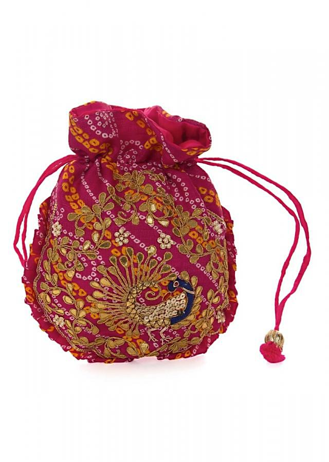 Rani pink bandhani potli bag beautified in gotta patti embroidered work only on Kalki