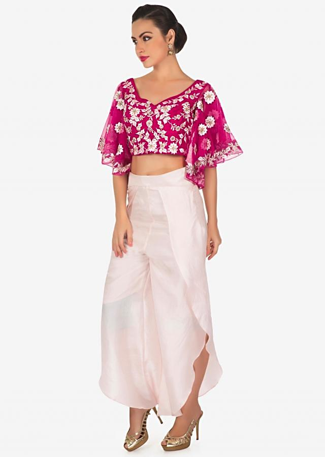 Rani pink crop top blouse embellished in resham with  pants only on Kalki