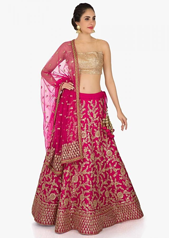 Rani pink lehenga in raw silk featuring the zari sequin embroidery only on Kalki