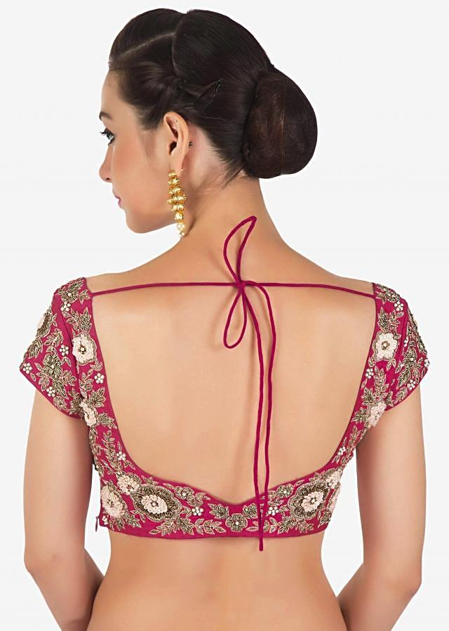 Rani pink lehenga set in raw silk adorn in french knot and zardosi embroidery only on Kalki