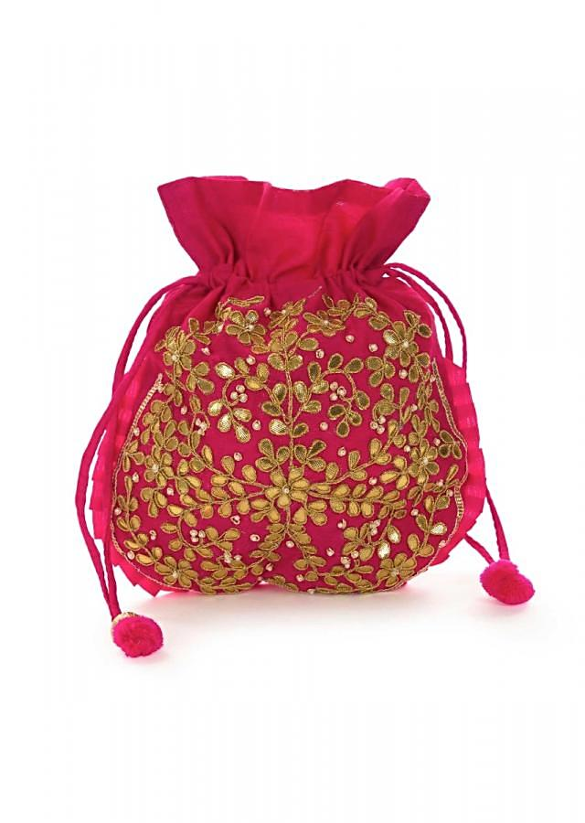 Rani pink potli bag beautified in gotta patti embroidered work only on Kalki