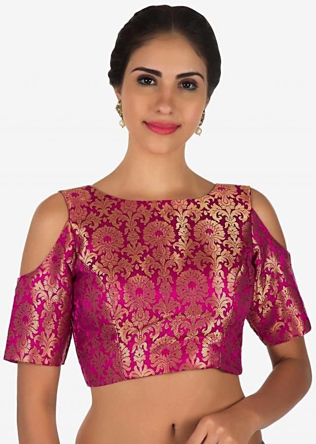 Rani pink silk blouse flaunting the cold shoulder pattern only on Kalki