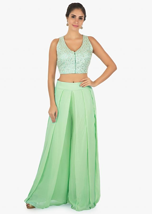 Raw silk blouse adorn in cut dana and moti work paired with a georgette sea green palazzo only on Kalki