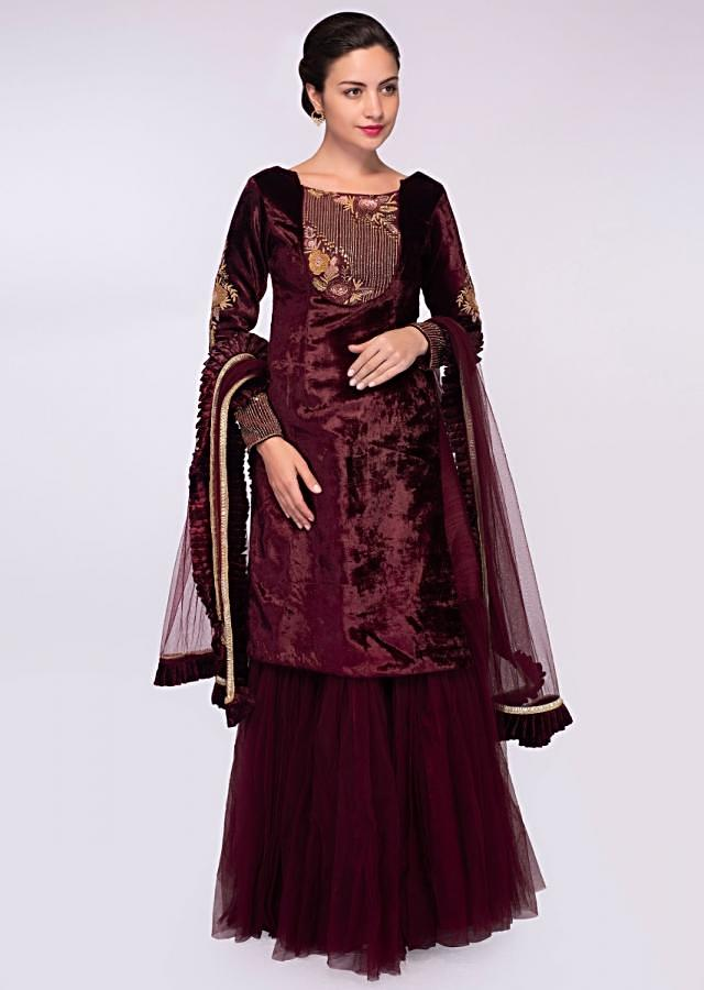 Wine Lehenga In Raw Silk With Net Gathers Paired With Velvet Long Top And Matching Net Dupatta Online - Kalki Fashion