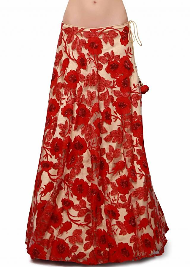 Red and beige lehenga enhanced in applique embroidery only on Kalki