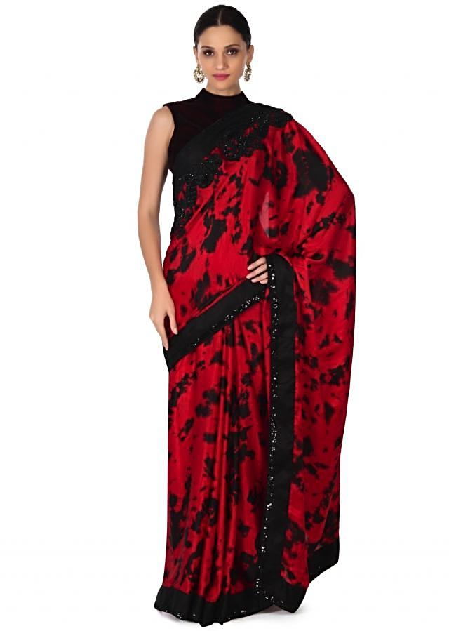 Tomato red and black saree adorn in sequin border only on Kalki