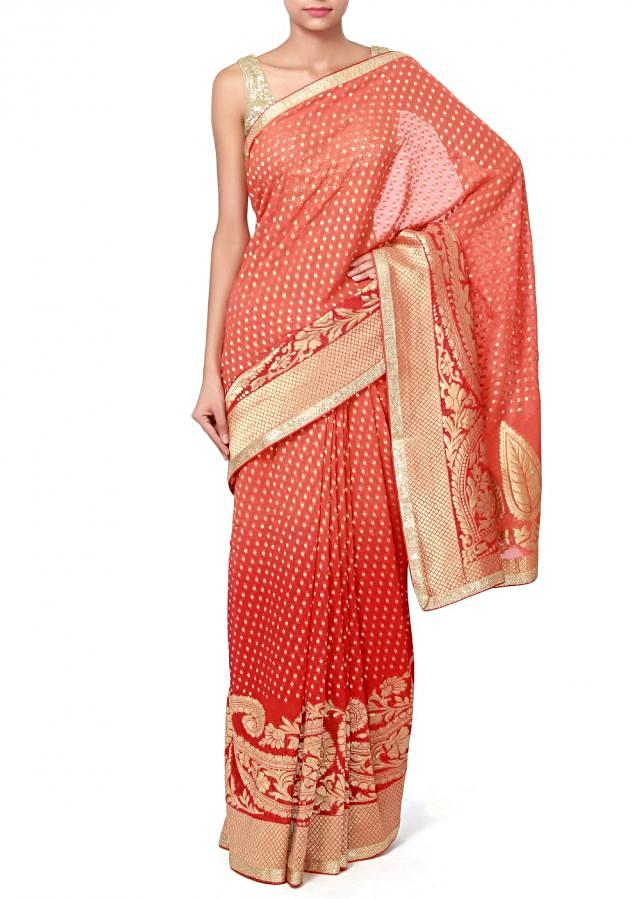Red and orange shaded saree adorn in weave embroidery only on Kalki