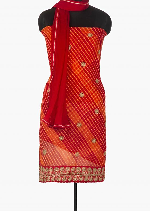 Red and orange unstitched suit in leheriya cotton with zari and sequin butti only on Kalki