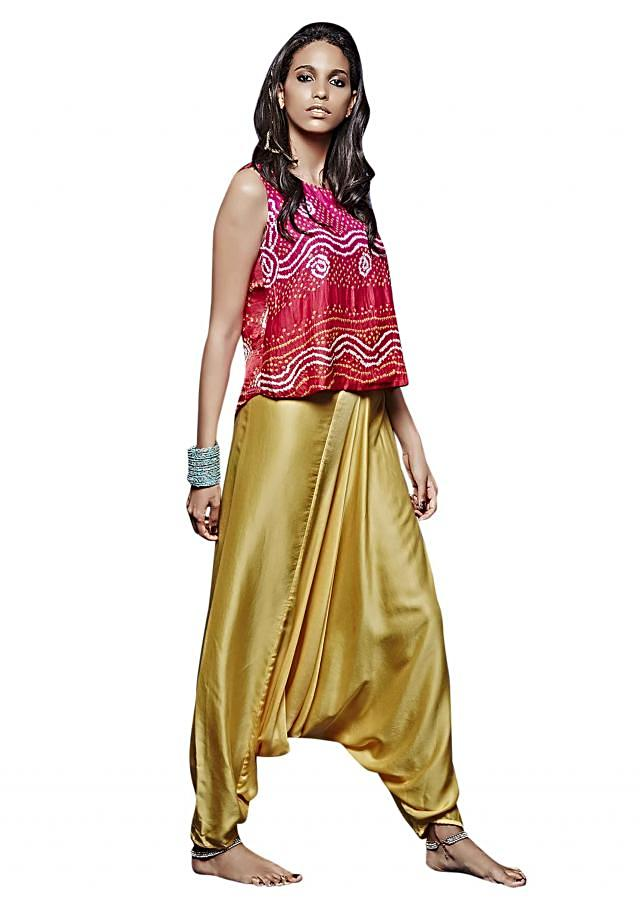 Red and pink bandhani top with yellow aladdin pants only on Kalki