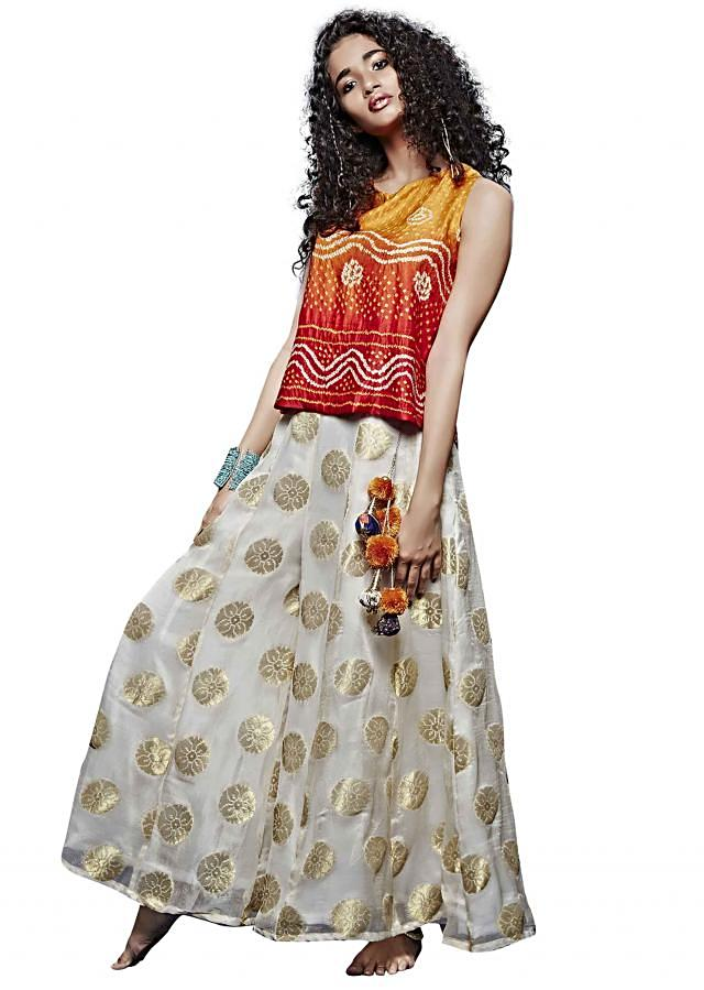 Red and orange bandhani top with white palazzo pants only on Kalki