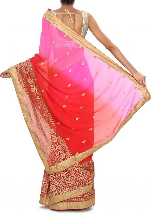 Red and pink saree embellished in zari embroidery all over only on Kalki