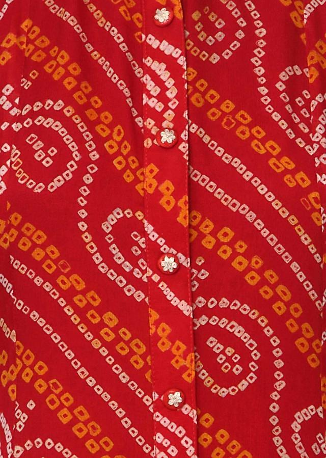 Red bandhani kurti enhanced in embroidered button only on Kalki