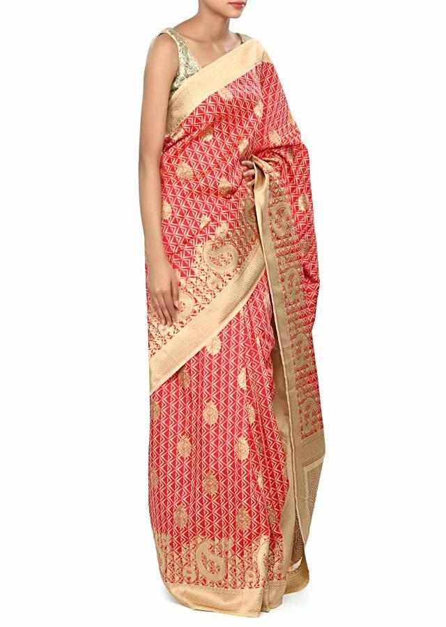 Red brocade saree enhanced in paisley motif border only on Kalki