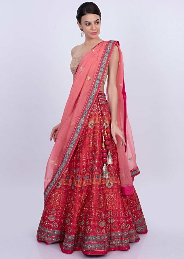 Red cotton silk printed lehenga with contrasting peach organza dupatta only on Kalki