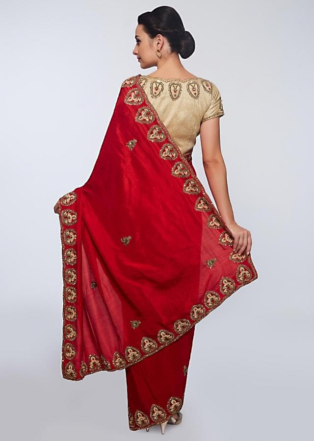 Red cotton silk saree in embroidered butti and border only on Kalki