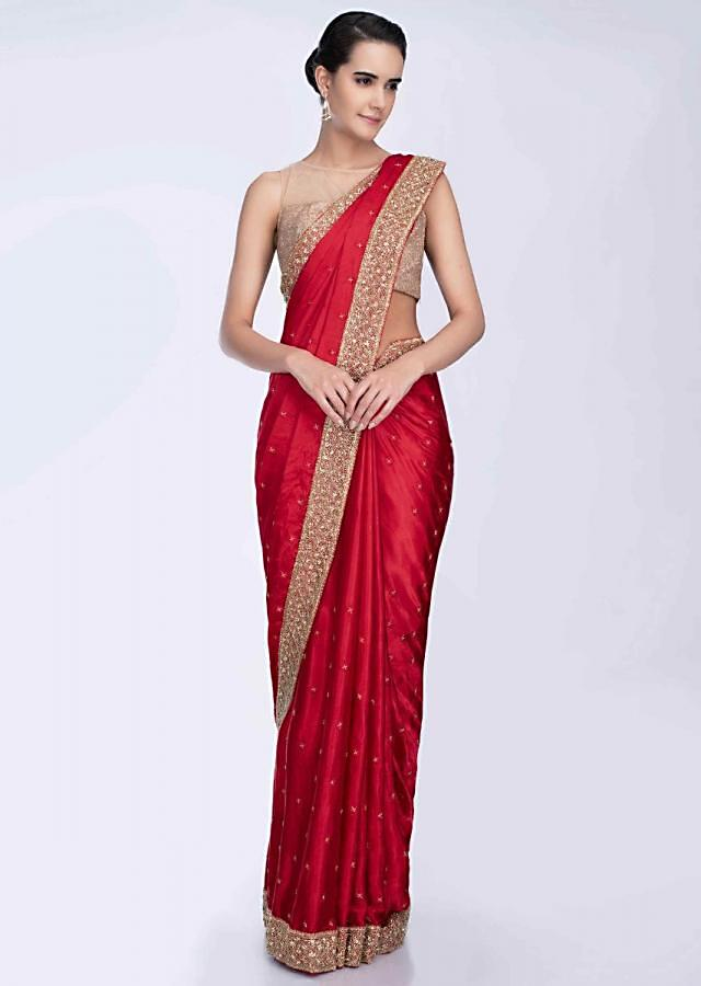 Red dupion satin saree with heavy embroidered border only on Kalki