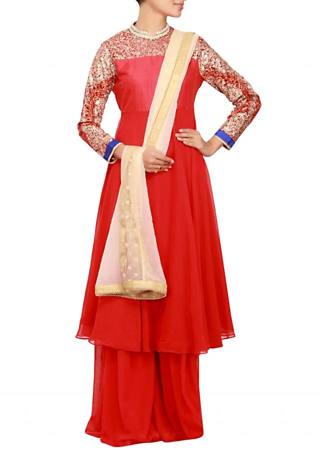 Red georgette a-line salwar kameez embellished in embossed zari work only on Kalki