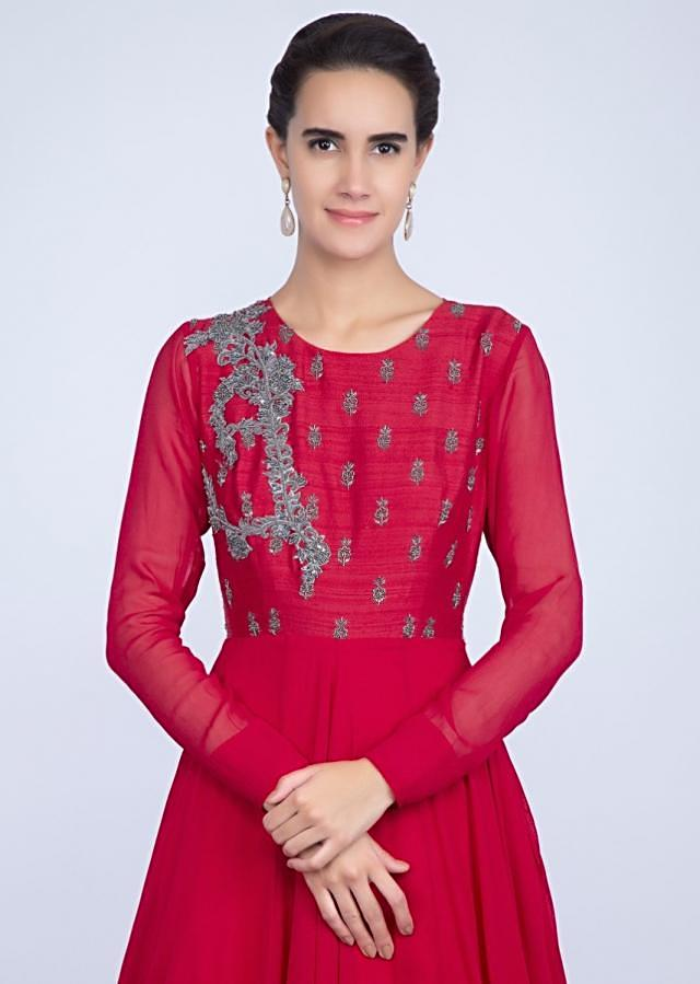Red gown with an embellished belt and a wrap around in frilled layer only on Kalki
