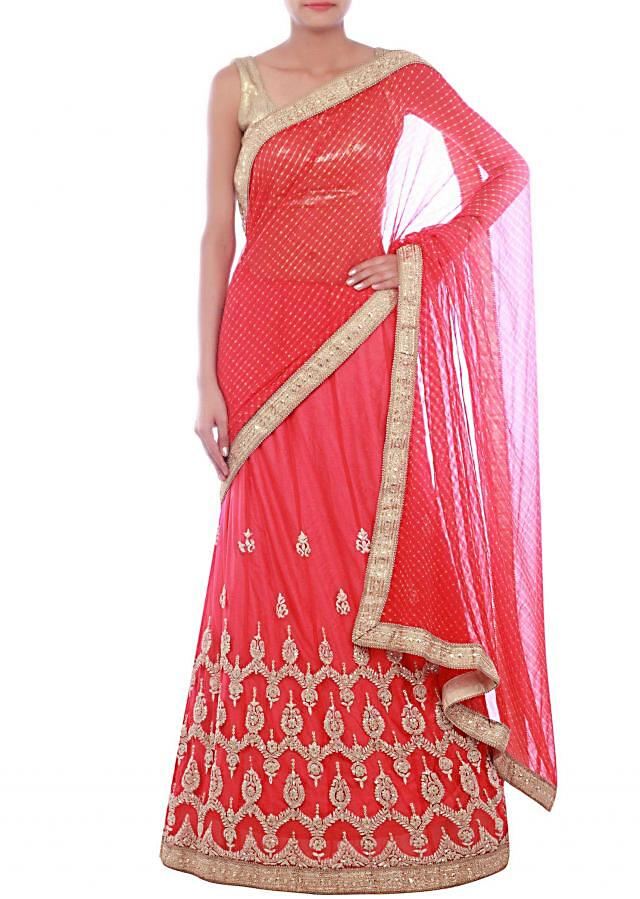 Red lehenga saree embellished in zari and sequins only on Kalki