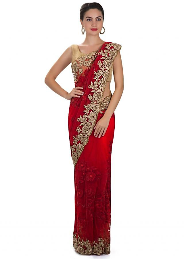 Red net saree featuring moti and zari work only on Kalki