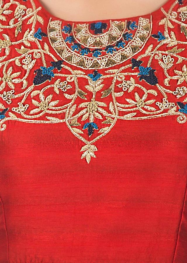 Red peplum top in zardosi embroidered neckline matched with fancy dhoti pants only on Kalki