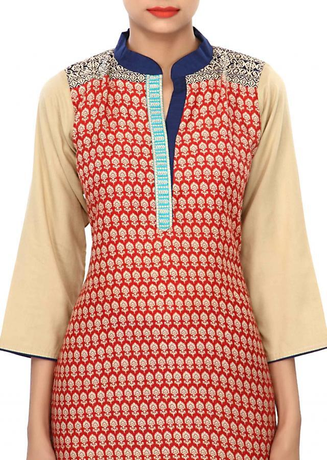 Red printed kurti enhanced in resham embroidery only on Kalki