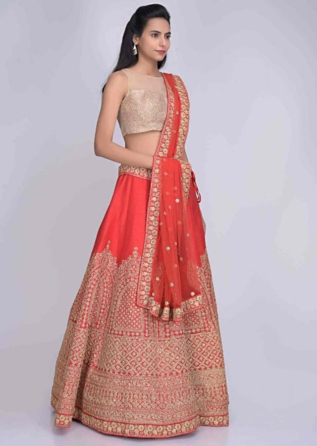Red raw adorned silk lehenga set with red net dupatta only on Kalki
