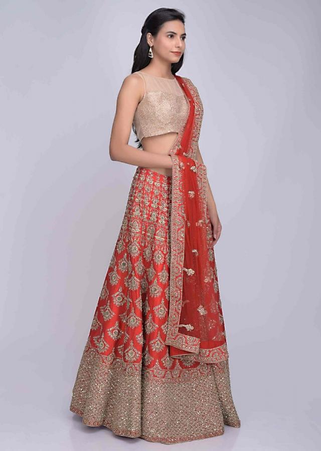 Red raw silk heavily embroidered lehenga set with red net dupatta only on Kalki