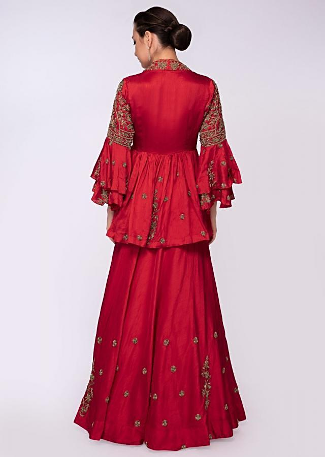 Red raw silk lehenga paired with peplum style blouse only on Kalki