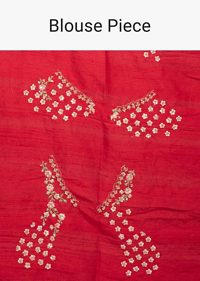 Red raw silk lehenga with pink net dupatta and unstitched red blouse only on Kalki
