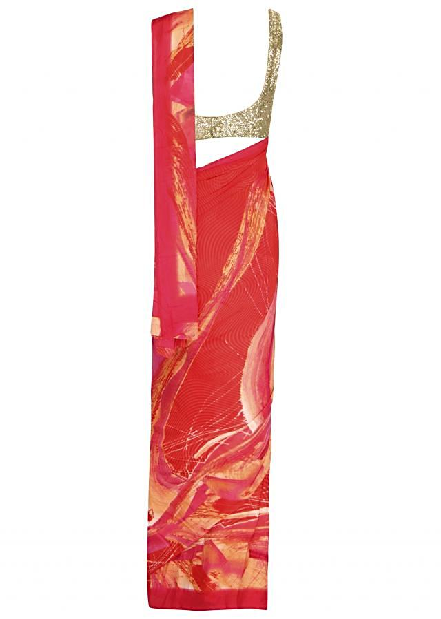 Red saree adorn in abstract print all over only on Kalki