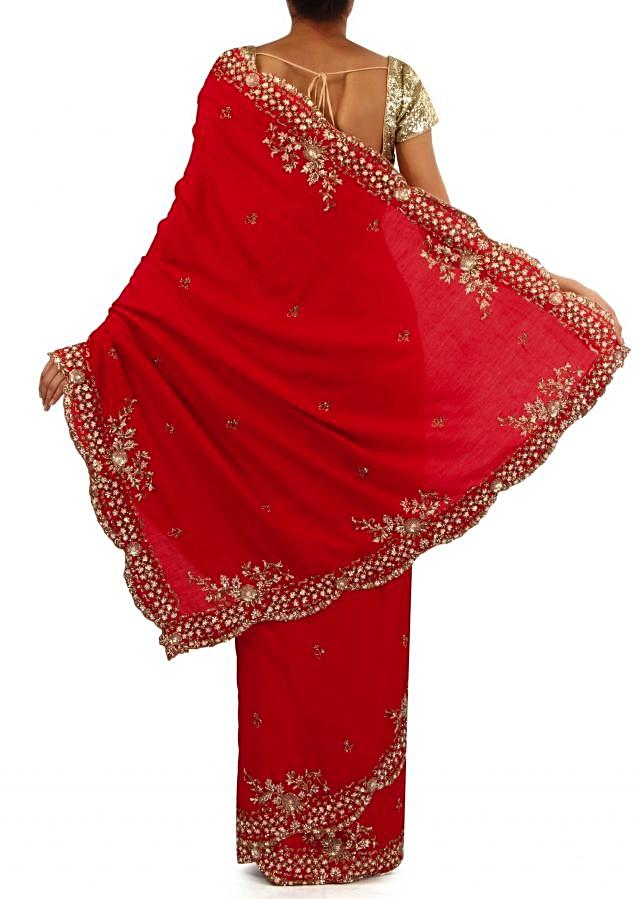 Red saree adorn in kundan embroidered border only on Kalki