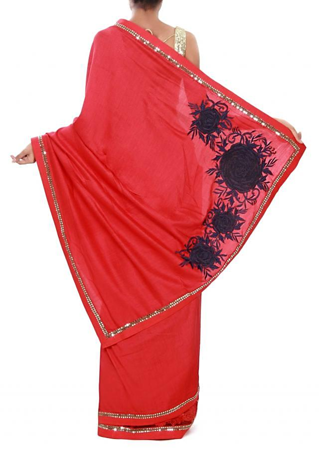 Red saree adorn in paisley motif embroidery only on Kalki