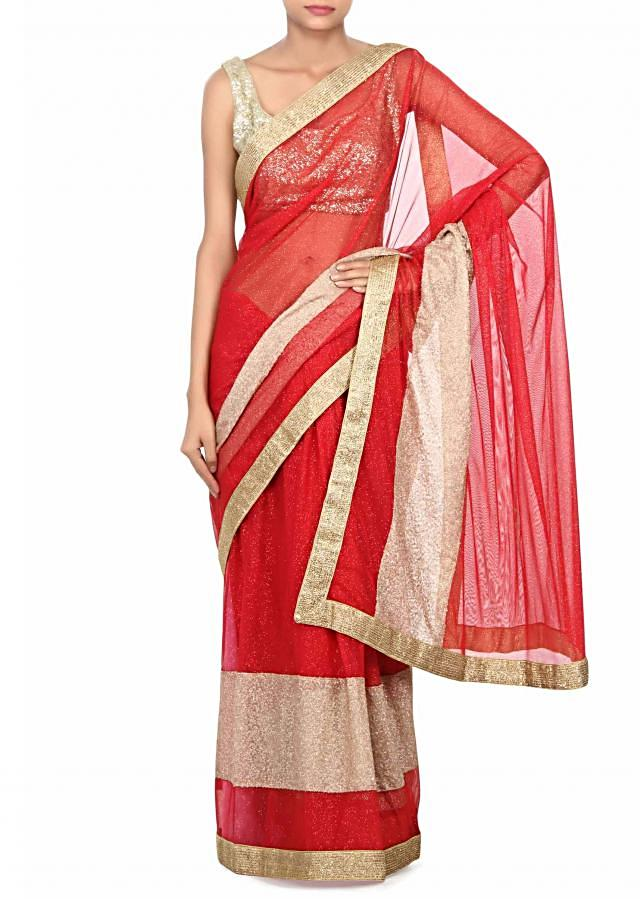 Red saree adorn in shimmer net with sequin border only on Kalki