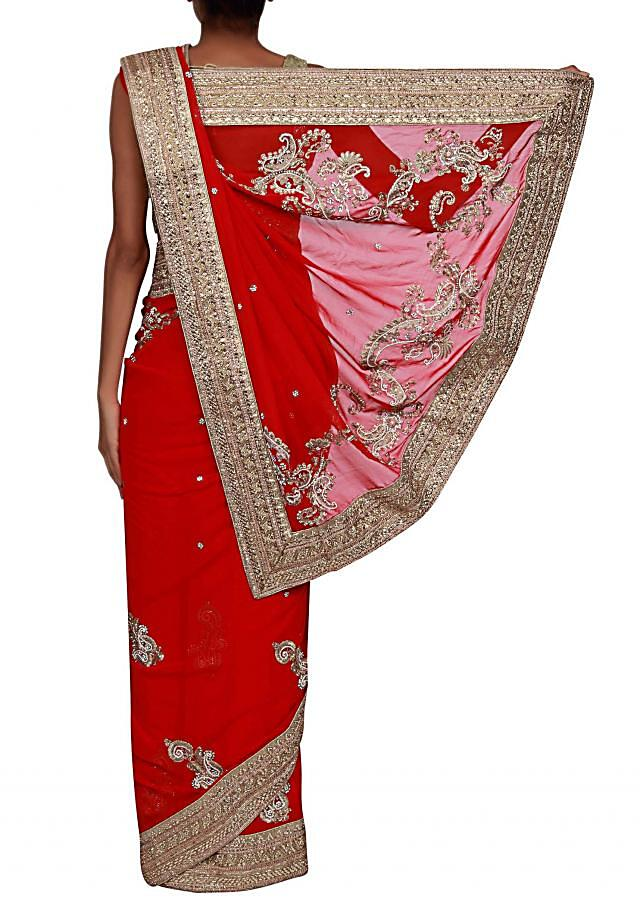 Red saree adorn in zari and kundan embroidery only on Kalki